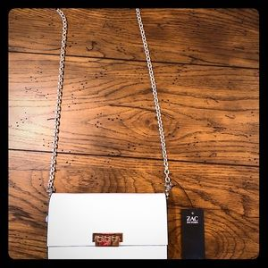 Zac Zac crossbody bag in natural and gold.